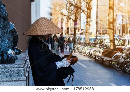 Japanese monk praying and asking for donations at Susukino Sapporo Hokkaido Japan