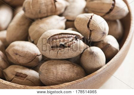 Pecan and coffee on rustic old wood, overhead view.