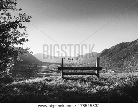 Enjoy a beautiful view from the hill on a bench. Camorino, Canton Ticino, Switzerland