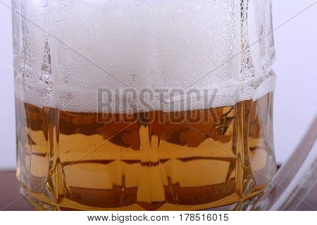Mug Fresh Beer With Cap Of Foam Close Up