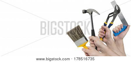 Hands Holding Paintbrush, Hammer, Pliers, And Square Ruler