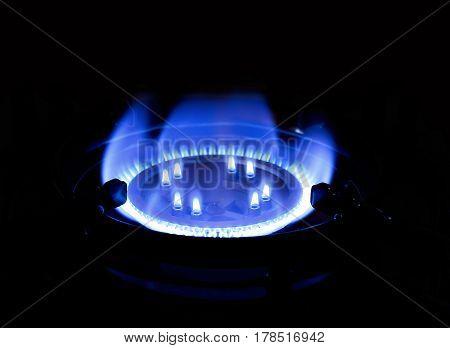 Burning natural gas on gas burner on dark background