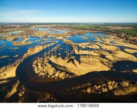Aerial panoramic view of the flooded blue river in spring