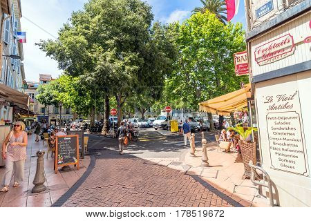 Antibes, France - June 29, 2016: day view of typical dowmtown street in Antibes France. Antibes is a popular seaside town in the heart of the Cote d'Azur.