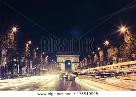 View Of Arc De Triomphe And The Avenue Champs-elysées By Night. Famous Touristic Places And Romantic