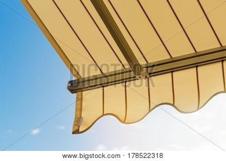 sun protection - awning against blue sky