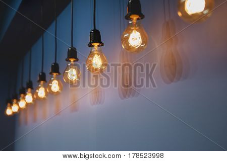 Decorative Antique Edison Style Light Bulbs Against Wall Background.
