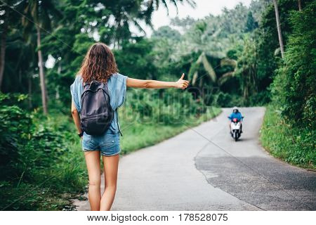 Young Beautiful Woman Hitchhiking Standing On Road