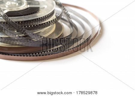 Old reels with a black and white film and magnetic tape