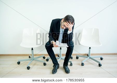 A man candidate is waiting for his job interview