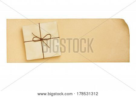 Beige gift box on the aged paper letter blank isolated on white background