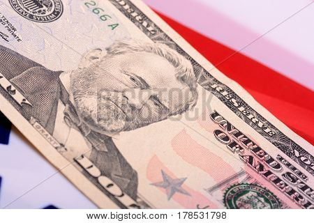 Fifty Dollar Bill In Front Of The American Flag