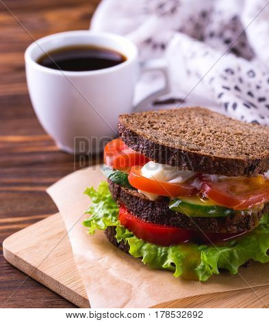 Sandwich With Cherry Tomatoes, Cucumber And Lettuce And Coffee