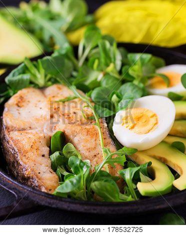 Grilled Sheatfish Fish Steak With Avocado, Arugula And Salad
