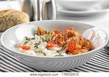 PLate with chicken tikka masala and rice, closeup