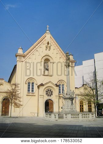 Capuchin Church and Monastery building and square in old town of Bratislava, capital of Slovakia, eastern Europe. Popular city tourist travel landmark, ancient architecture church during early morning day hours.