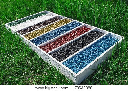 colorful rocks in wooden box On the green grass, art Aquarium Fish Tank Gravel Stones Color For decoration