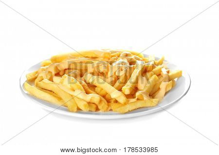 Plate of delicious french fries with cheese sauce on white background
