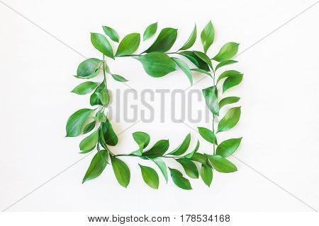 Frame made of green leaves. Leaf pattern. Flat lay top view