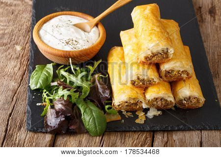 Crispy Rolls Borek With Minced Meat And Eggs Close-up On The Table. Horizontal