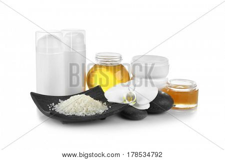 Spa setting with honey and nutrient cosmetic on white background