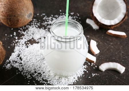 Composition with fresh coconut milk on dark table