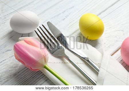 Beautiful Easter table setting on wooden table