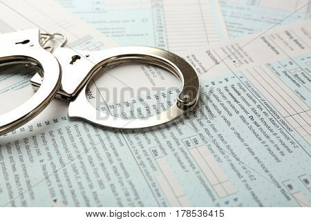 Handcuffs on income tax return form background