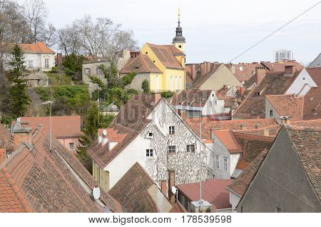 View of tower and roofs of the city from the terrace of the Kastner and Ohler warehouses in Graz the capital of federal state of Styria Austria.
