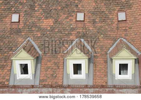 Dormer windows on a red tile roof in a building of Graz the capital of federal state of Styria Austria.