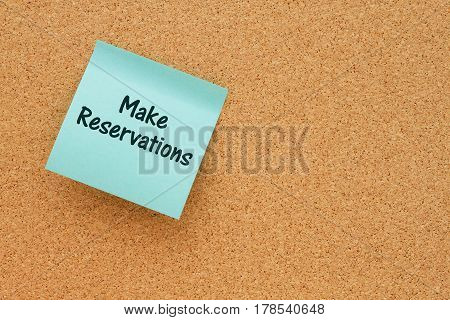 A reminder to make reservations Bulletin board with a teal sticky note with text Make Reservations