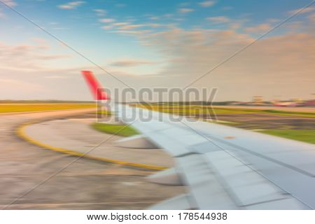 Abstract blur  Wing while breaking during landing on runway