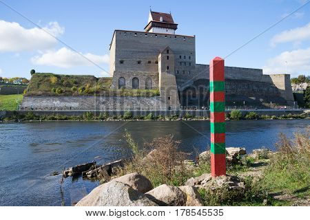 A russian border post on the background of the Narva river and the Herman castle. The state border with Estonia and Russia
