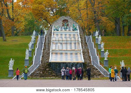 ST. PETERSBURG, RUSSIA - OCTOBER 05, 2015: View of the Chess Mountain cascade in the October afternoon. Complex of fountains of Peterhof