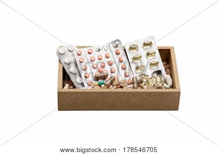 Set of different pills tablets and capsules of cod-liver oil in blisters isolated on white background