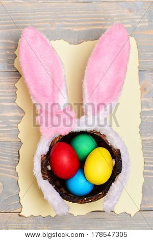 Colorful Eggs Inside Bucket And Rabbit Ears. Happy Easter Concept