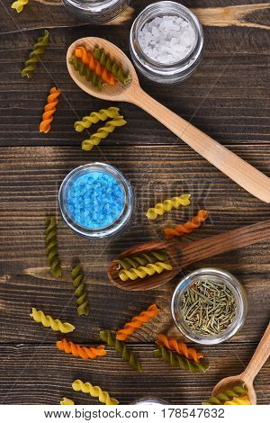 Dried Fusilli And Salt Crystals, Spices In Glass Jars