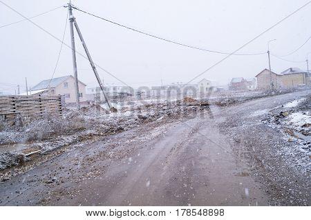 Heavy snow land road at winter background slush