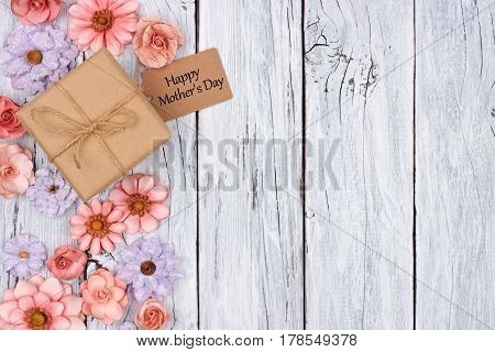 Side Border Of Paper Flowers With Mother's Day Gift Box And Tag Against A Rustic White Wood Backgrou