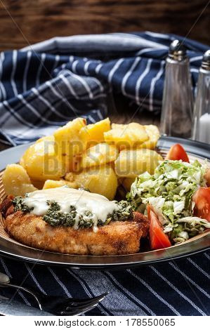 Fried Chicken Fillet With Spinach And Cheese.