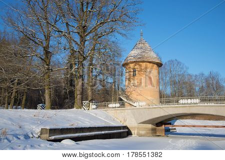 View of the ancient Pil-tower on a sunny February day. Pavlovsky palace park St. Petersburg. Russia
