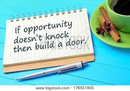 If opportunity doesn't knock then build a door written on notepad closeup