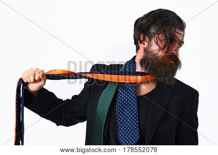 Brutal Caucasian Hipster In Black Suit Holding Ties Around Neck