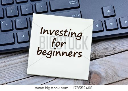 Investing for beginners words on notes closeup