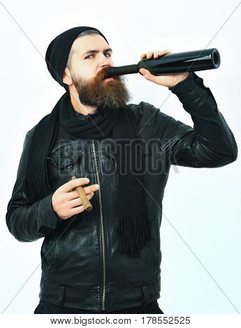 Bearded Brutal Caucasian Hipster Drink From Bottle And Smoking Cigar