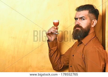 Brutal Caucasian Hipster Holding Alcoholic Shot