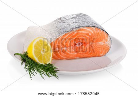 Raw Steak Of Salmon On White Plate Isolated