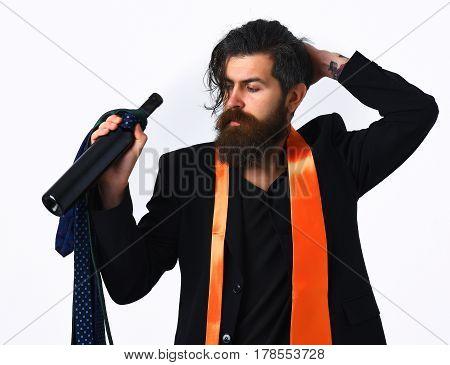 Brutal Caucasian Hipster With Ties On Shoulder Holding Bottle