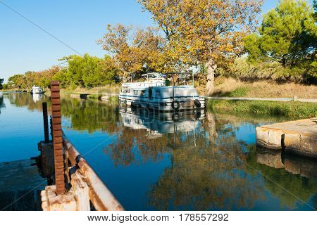 Canal boats tied along canal in Canal de la Robine lock Ile Sainte Lucie Port Nouvelle France