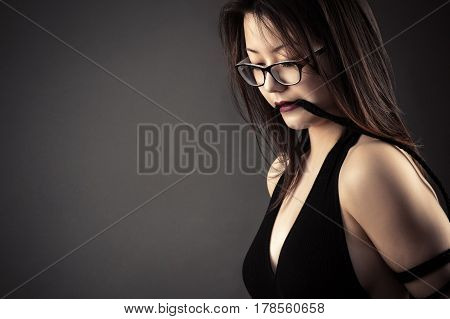 young beautiful girl with rope in mouth
